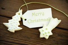 Christmas Greetings on a Label with Christmas Cookies Stock Image