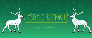 Christmas greetings postcard. Two magic dots rein deers hanging a ribbon and wishing merry christmas on a green snowy horizontal background Royalty Free Stock Photography