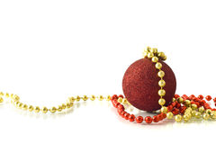 Christmas greetings - single red ball and beads Royalty Free Stock Photo