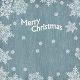 Christmas greetings with snowflakes on wooden text Royalty Free Stock Image