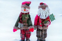 Christmas greetings. Two Christmas toys on a snow background Royalty Free Stock Photos