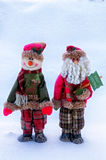 Christmas greetings. Two Christmas toys on a snow background Royalty Free Stock Images