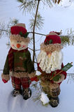 Christmas greetings. Two Christmas toys on a snow background Royalty Free Stock Photography
