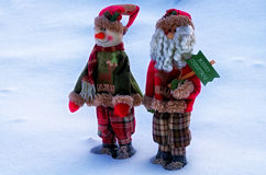 Christmas greetings. Two Christmas toys on a snow background Stock Photos