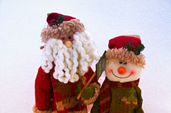 Christmas greetings. Two Christmas toys on a snow background Stock Photography