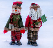 Christmas greetings. Two Christmas toys on a snow background Stock Image
