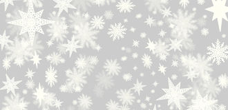 Christmas grey background with a lots of snow flakes and stars w Stock Photo