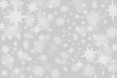 Christmas grey background with a lots of snow flakes and stars w Royalty Free Stock Photo