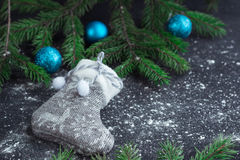 Christmas grey stocking on snowbound black background with blue Royalty Free Stock Photo