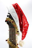 Christmas guitar and cap Stock Image
