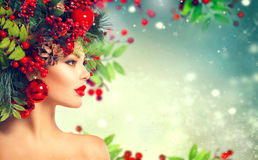 Christmas hairstyle. Holiday makeup Stock Photos