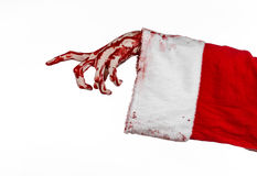 Christmas and Halloween theme: Santa Zombie bloody hand on a white background Stock Images