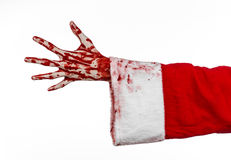 Christmas and Halloween theme: Santa Zombie bloody hand on a white background. Studio Royalty Free Stock Image