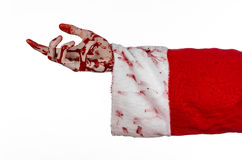 Christmas and Halloween theme: Santa Zombie bloody hand on a white background. Studio Stock Images