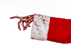 Christmas and Halloween theme: Santa Zombie bloody hand on a white background Stock Photo