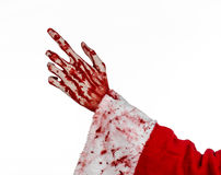 Christmas and Halloween theme: Santa Zombie bloody hand on a white background. Studio Stock Image