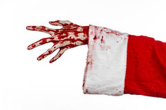 Christmas and Halloween theme: Santa Zombie bloody hand on a white background. Studio Stock Photography
