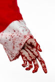 Christmas and Halloween theme: Santa Zombie bloody hand on a white background Royalty Free Stock Photography