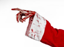 Christmas and Halloween theme: Santa Zombie bloody hand on a white background. Studio Royalty Free Stock Images