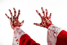 Christmas and Halloween theme: Santa Zombie bloody hand on a white background. Studio Stock Photo