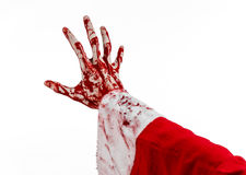 Christmas and Halloween theme: Santa Zombie bloody hand on a white background Royalty Free Stock Photo