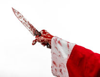 Christmas and Halloween theme: Santa Zombie bloody hand on a white background Royalty Free Stock Photos