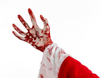 Christmas and Halloween theme: Santa Zombie bloody hand on a white background. Studio Royalty Free Stock Photography