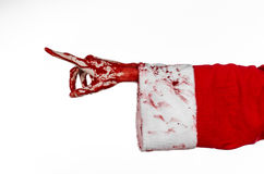 Christmas and Halloween theme: Santa Zombie bloody hand on a white background. Studio Royalty Free Stock Photos