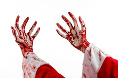 Christmas and Halloween theme: Santa Zombie bloody hand on a white background. Studio Stock Photos