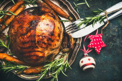 Christmas ham on plate with festive decoration and cutlery. Top view Royalty Free Stock Image
