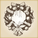 Christmas hand drawn vector illustration - Decorative wreath sketch, vintage style. Brown paper background Royalty Free Stock Photography