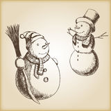 Christmas hand drawn vector illustration - snowman, vintage style. Brown paper background Royalty Free Stock Image