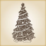 Christmas hand drawn vector illustration - Xmas tree, vintage style. Brown paper background Stock Images