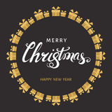 Christmas hand lettering with gold  gift boxes on black  backgr. Merry Christmas hand lettering with gold  gift boxes on black  background. Vector greeting  card Stock Images