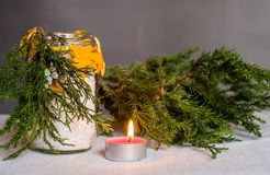 Christmas hand made candle craft on the table with a fir tree spruce and a candle Royalty Free Stock Photos
