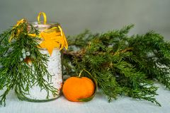 Christmas hand made candle craft on the table with a fir tree spruce and orange Royalty Free Stock Photos