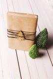 Christmas handcraft gift box on wood background. Stock Image