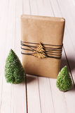 Christmas handcraft gift box on wood background. Royalty Free Stock Photos