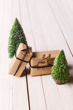 Christmas handcraft gift boxes on wood background. Royalty Free Stock Photography