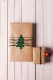 Christmas handcraft gift boxes on wood background. Stock Image