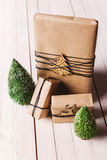 Christmas handcraft gift boxes on wood background. Stock Photos