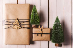 Christmas handcraft gift boxes on wood background. Stock Images