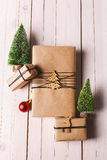 Christmas handcraft gift boxes on wood background. royalty free stock photo