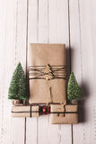 Christmas handcraft gift boxes on wood background. Stock Photo