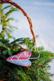 Christmas handmade blue and red fabric heart decorations and gift bag with fir branches in snowy winter, selective focus Stock Image