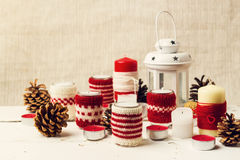 Christmas handmade. Christmas candles in the candle holders knit Royalty Free Stock Photography