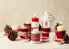 Christmas handmade. Christmas candles in the candle holders knit Stock Photography