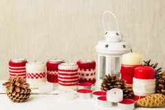Christmas handmade. Christmas candles in the candle holders knit Royalty Free Stock Image