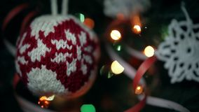 Christmas handmade decoration a knitted ball and a crocheted snowflake. stock video