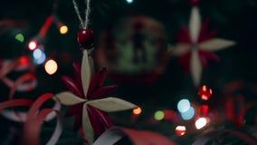 Christmas handmade decoration a wooden snowflake and a knitted ball. Christmas handmade decoration wooden snowflake and a knitted ball. Lights flash stock video